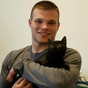 Man Holding a Black Cat
